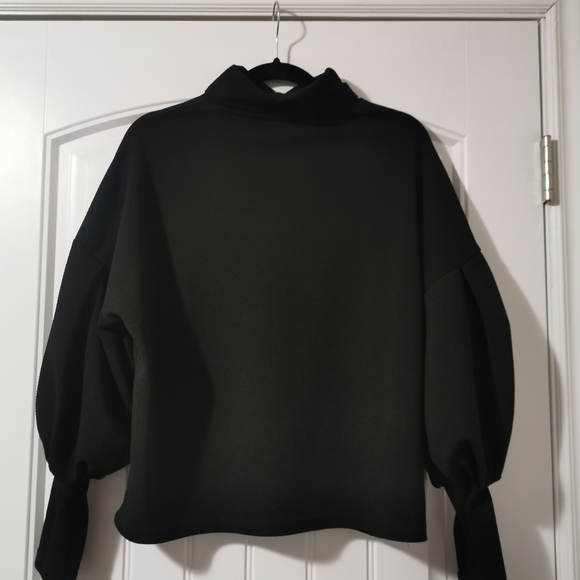 Black puff sleeve turtle-neck sweater